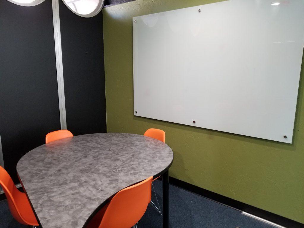 orange chairs and white board