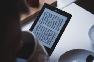 kindle and coffee cup