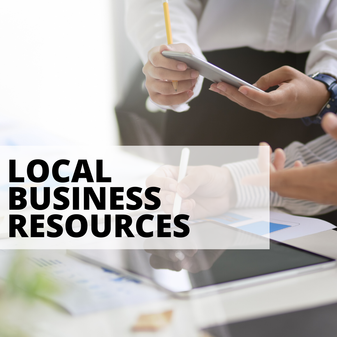 local business resources with woman holding notebook