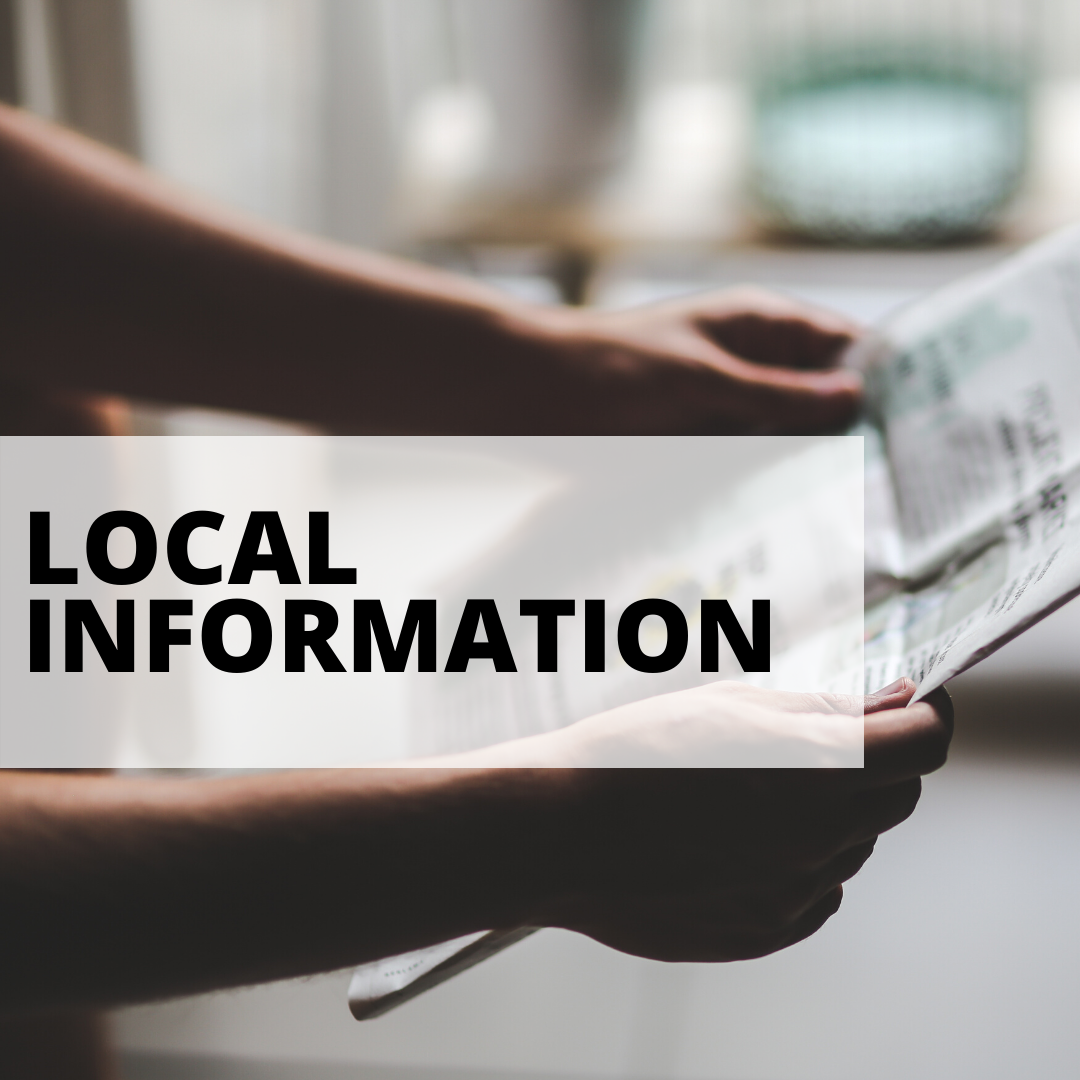 local information with man reading newspaper in background