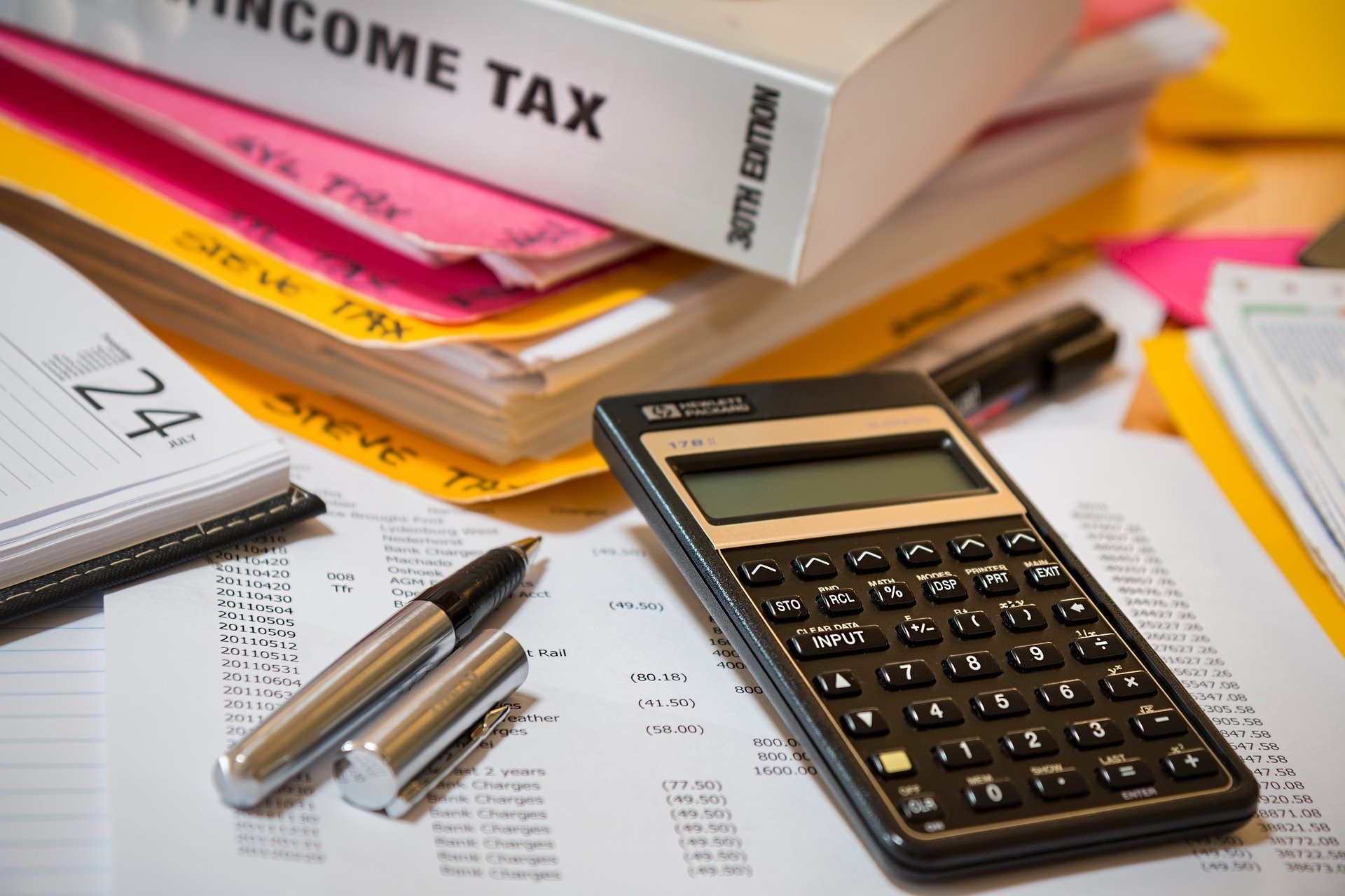 calculator and pile of tax books