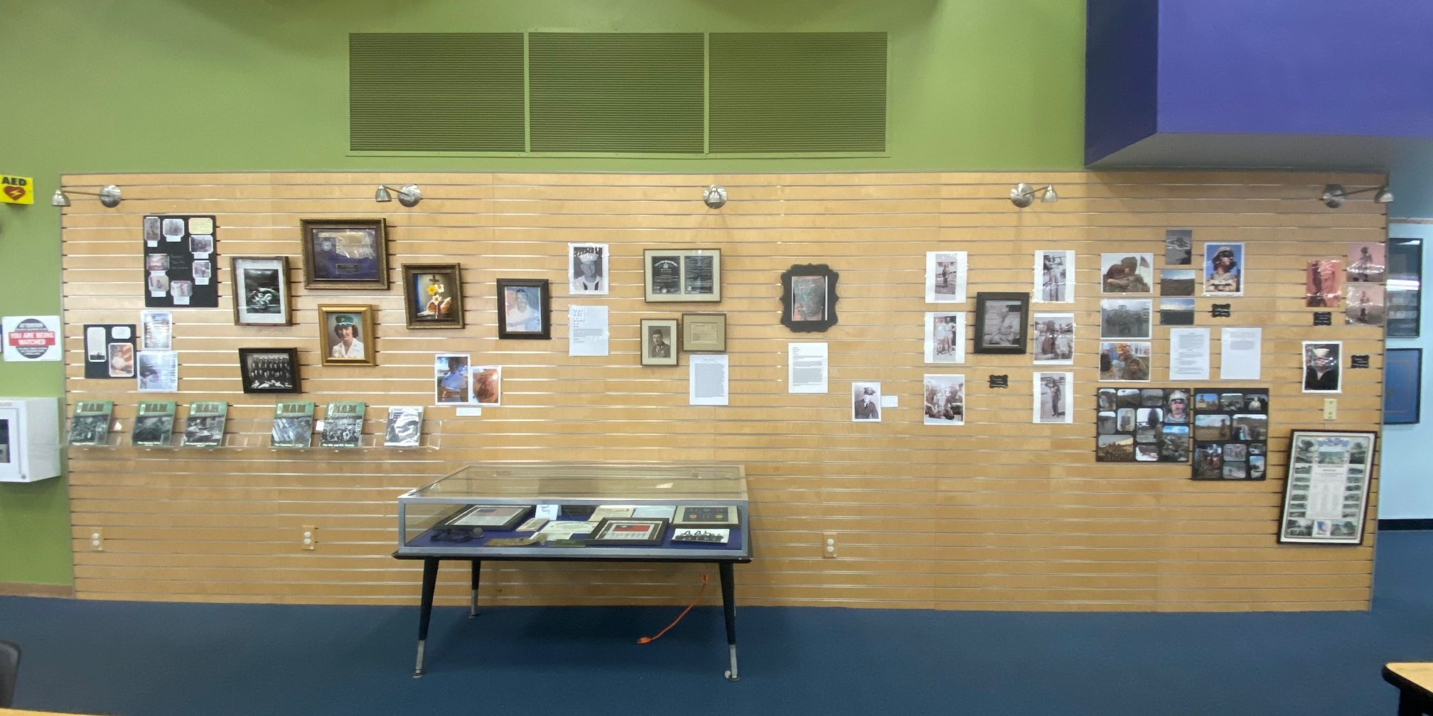 wall with photos and picture frames